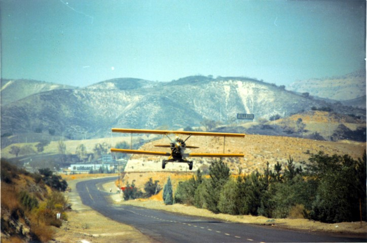 Biplane taking off from road (Small)